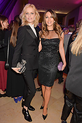 Left to right, EVA HERZIGOVA and ELIZABETH HURLEY at the Alexandra Shulman and Leon Max hosted opening of Vogue 100: A Century of Style at The National Portrait Gallery, London on 9th February 2016.