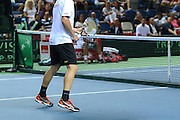 Tennis concept player up by the net