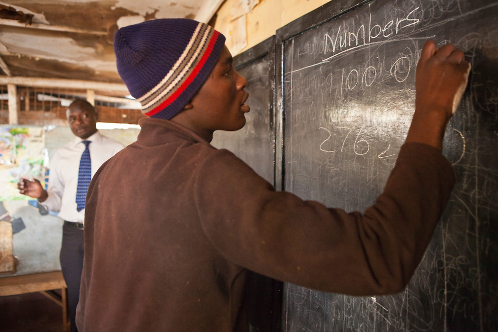 Peter teaches maths to young men training to become mechanics as part of the Into Work programme run by Action for children in conflict (AFCIC) in Thika, Kenya.  They go to school between 7 and 9 am to learn literacy and maths, followed by going to various garages to learn the practical skills.