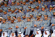 Military chiefs in uniform watching parade of armed forces in Abu Dhabi, United Arab Emirates