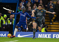 Football - 2018 / 2019 Premier League - Chelsea vs. Leicester City<br /> <br /> Ngolo Kante (Chelsea FC) and the giant frame of Harry Maguire (Leicester City) tussle for the ball at Stamford Bridge <br /> <br /> COLORSPORT/DANIEL BEARHAM