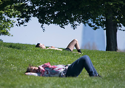 © Licensed to London News Pictures. 20/04/2020. London, UK. People sunbathing on Primrose Hill, north London during a pandemic outbreak of the Coronavirus COVID-19 disease. The public have been told they can only leave their homes when absolutely essential, in an attempt to fight the spread of coronavirus COVID-19 disease. Photo credit: Ben Cawthra/LNP. Photo credit: Ben Cawthra/LNP