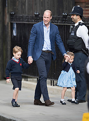 © Licensed to London News Pictures. 23/04/2018. London, UK. PRINCE WILLIAM smiles as he leads Prince George and Princess Charlotte in to visit THE DUCHESS OF CAMBRIDGE in the Lindo Wing at St Mary's Hospital in London. The Duchess gave birth to a baby boy earlier today. Photo credit: Peter Macdiarmid/LNP