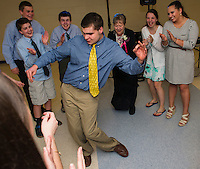 Max Sawyer shows off his dance moves with Sam Sawyer, Mitchell Mattice, Joe Sawyer, Grace Herbert, Stratton Coleman and Noelle Benavides during Gilford High School's Senior Senior dance put on by the Student Council and Interact Club Wednesday evening.  (Karen Bobotas/for the Laconia Daily Sun)