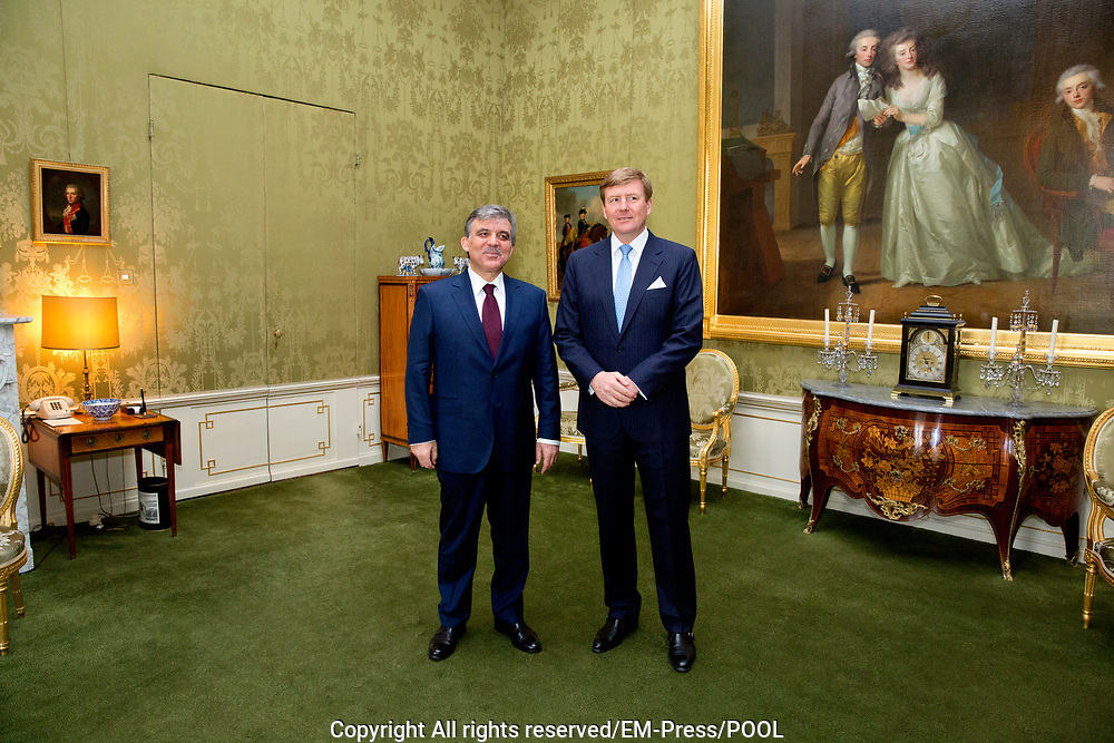 King Willem-Alexander of The Netherlands receives President Gul of Turkey during an audience at Palace Huis ten Bosch, The Hague, The Netherlands, 23 March 2014.