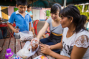 28 MARCH 2013 - BANGKOK, THAILAND:  Michelle Kao socializes with some of her neighbors.    PHOTO BY JACK KURTZ