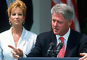 U.S. President Bill Clinton discusses worker rights in the clothing industry with celebrity Kathy Lee Gifford in the Rose Garden at the White House August 2, 1997 in Washington, DC.
