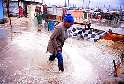 South Africa Cape Town 11 June 2020 Vuyiseka Mzi struggling with flooded home. Flooded in Zwezwe Informal Settlement in Khayelitsha. All their belongings have been damaged as water continues to flood inside their homes due to heavy rains. Heavy rainfall has graced many areas in Khayelitsha and the rest of the province. The rest of the week is expected to bring even more rain, with gale force winds and chilly temperatures. Photographer Ayanda Ndamane African news agency/ANA