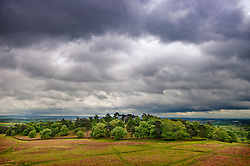 Storm clouds over woodland at Bradgate Country Park, Leicestershire, England.