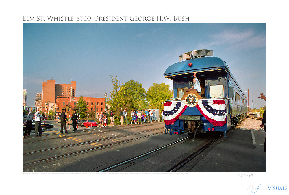 George H. W. Bush, 41st U.S. President, makes a brief stop on South Elm St. in Greensboro, NC while conducting a whistle-stop tour of parts of North Carolina during his 1992 presidential campaign. Bush was defeated by Bill Clinton.<br /> <br /> Photographed, October 22, 1992, in Greensboro N.C. JERRY WOLFORD  / Perfecta Visuals