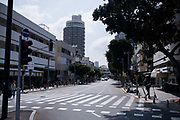 The outbreak of COVID-19 has forced governments around the world to impose a civil quarantine. The outcome of this are empty streets and public places. Photographed on Dizengoff street, Tel Aviv, Israel on April 8th 2020