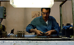 HERSTAL, BELGIUM - JUNE-13-2003 - Shell casings are inspected by hand before being loaded with live rounds at the FN Herstal weapons fabrication plant near Liege, Belgium. (PHOTO © JOCK FISTICK)