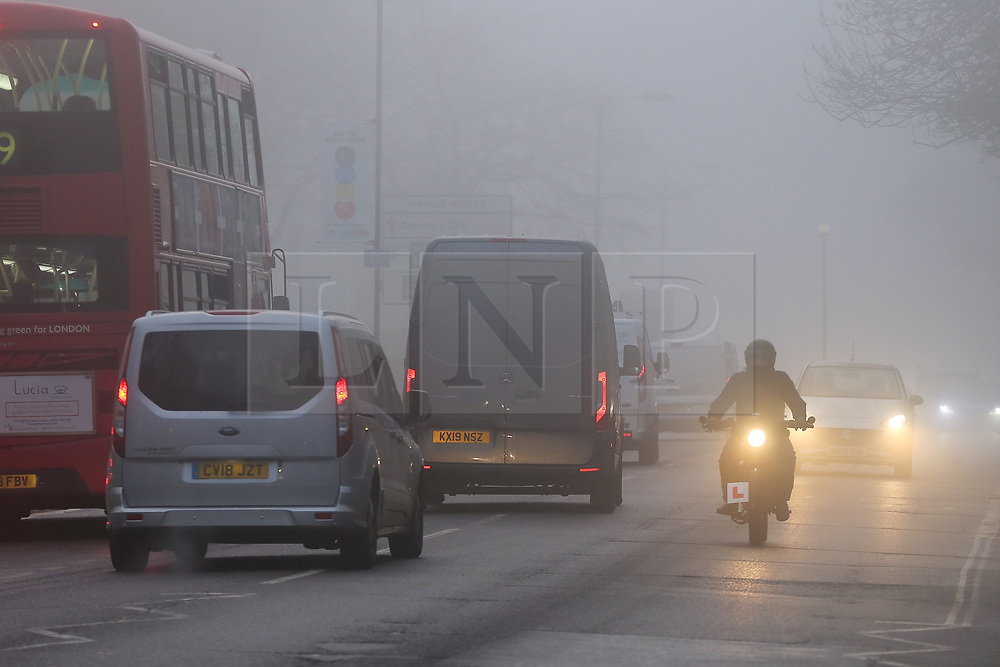 © Licensed to London News Pictures. 08/12/2020. London, UK. Fog shrouds traffic on Green Lanes in north London as many parts of the UK wakes to freezing temperatures. The Met Office has issued a yellow weather warning for the UK unlit 11am for low visibility. Photo credit: Dinendra Haria/LNP