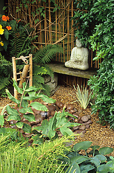 Oriental bamboo water feature with buddha statue