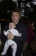 Jamie Oliver and baby Poppy Oliver. Afternoon tea party before the Frost French fashion show. Regents Park. 15 September 2002. © Copyright Photograph by Dafydd Jones 66 Stockwell Park Rd. London SW9 0DA Tel 020 7733 0108 www.dafjones.com