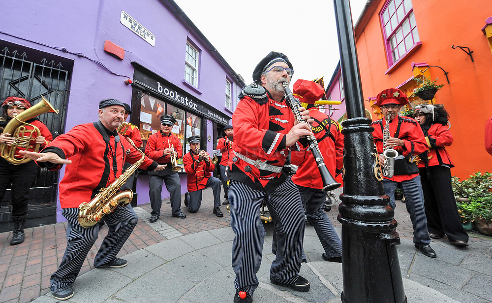 REPRO FREE<br /> 'The French Connection' a French Marching Band performing on the street at The Guinness Kinsale Fringe Jazz Festival at the weekend.<br /> Picture. John Allen<br /> <br /> PRESS RELEASE<br /> <br /> 28th October 2016<br /> <br /> KINSALE JAZZIN' AND LOTS OF HALLOW'EEN ACTIVITIES THIS WEEKEND!<br /> The Guinness Kinsale Fringe Jazz Festival Weekend has finally arrived! After months of preparation and planning, several Kinsale businesses are gearing up for an action packed weekend of jazz, blues and fun. <br /> The streets have been renamed 'Bourbon Street', 'Canal Street', 'The French Quarter' and 'St. Charles Ave', and are adorned with banners and bunting. <br /> The bands are booked and Kinsale welcomes all visitors and locals who enjoy a weekend of live music and craic. The fringe festival runs concurrently with the Guinness Cork Jazz Festival and offers<br /> There are over 100 live gigs in many hotels and pubs, including Lila Ammons, guest jazz singer originally from Chicago, who performs on Friday 28th October at The Trident Hotel from 5pm accompanied by Billy Crosbie and friends. Lila will perform a few numbers in other venues on Friday night and on Saturday afternoon.<br /> The Guinness Kinsale Fringe Jazz programme includes favourite acts such as Two Time Polka, The Roaring 40s, Loose Change, The Chris Hayward & Gary Potter Trio, Stringfellows, Crazy Chester and the ever popular Sharon Crosbie who all play various gigs around Kinsale throughout the jazz weekend.<br /> Saturday 29th October has an action-packed schedule in the afternoon, kicking off with Sharon Crosbie at The Folk House, Gentleman Tim & The Contenders at The Wharf Tavern and 2D Fingers and 2 Hands at the Armada. Look out for King K at the White House and the Groove Collection at The Blue Haven. <br /> On Sunday 30th October, 'The French Connection' a French Marching Band, will play as they march from The Spaniard at 2pm and perform on Pearse Street, before popping in to vario