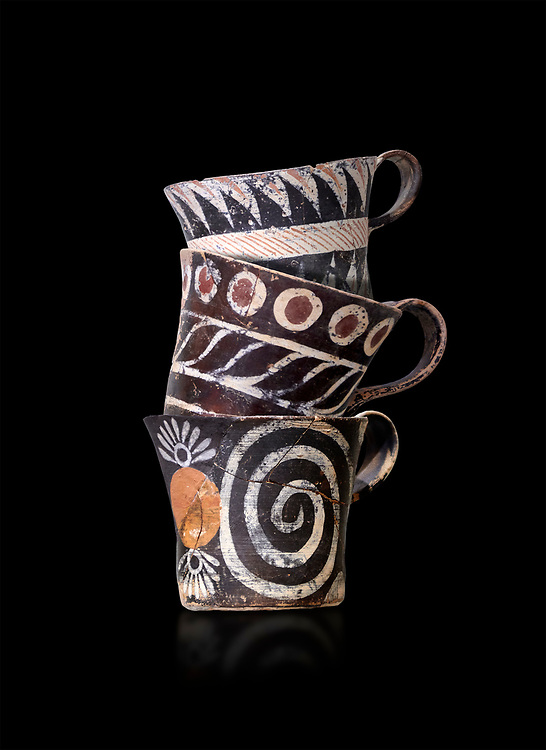 """Minoan Kamares """"eggshell"""" ware cups with  with  polychrome decorations, from set found at Phaistos Palace 1800-1600 BC; Heraklion Archaeological  Museum, black background.<br /> <br /> These cups found as parts of sets in Phaistos palace were names """"eggshell"""" ware due to the very thin walls of the cups. This style of pottery is named afetr Kamares cave where this style of pottery was first found .<br /> <br /> If you prefer to buy from our ALAMY PHOTO LIBRARY  Collection visit : https://www.alamy.com/portfolio/paul-williams-funkystock/minoan-art-artefacts.html . Type -   Heraklion   - into the LOWER SEARCH WITHIN GALLERY box. Refine search by adding background colour, place, museum etc<br /> <br /> Visit our MINOAN ART PHOTO COLLECTIONS for more photos to download  as wall art prints https://funkystock.photoshelter.com/gallery-collection/Ancient-Minoans-Art-Artefacts-Antiquities-Historic-Places-Pictures-Images-of/C0000ricT2SU_M9w"""