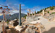 The Tripod of Plataeans column and the Altar of the Chiots with the columns of the temple of Apollo behind, Delphi Archaeological site, Delphi, Greece .<br /> <br /> If you prefer to buy from our ALAMY PHOTO LIBRARY  Collection visit : https://www.alamy.com/portfolio/paul-williams-funkystock/delphi-site-greece.html  to refine search type subject etc into the LOWER SEARCH WITHIN GALLERY.<br /> <br /> Visit our ANCIENT GREEKS PHOTO COLLECTIONS for more photos to download or buy as wall art prints https://funkystock.photoshelter.com/gallery-collection/Ancient-Greeks-Art-Artefacts-Antiquities-Historic-Sites/C00004CnMmq_Xllw