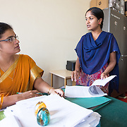 CAPTION: Accredited Social Health Activist (ASHA) Supervisor Lakshmi meets with Taluk Health Officer Dr Mallika to discuss ASHA incentives. Under the Chamkol programme, ASHAs will soon start receiving focussed training on ways to minimise the risk of disability during pregnancy, childbirth or infancy, on how to identify and respond to suspected impairments and how to care for, nurture and support children with different impairments. LOCATION: Chamarajanagar (town), Chamrajnagar (district), Karnataka (state), India. INDIVIDUAL(S) PHOTOGRAPHED: Dr Mallika B. (left) and Lakshmi C. (right).