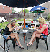 Here, Vicki Moore of Crystal River, Florida (left) and Maureen Wolfe of Bethalto eat outside, in the beer garden. They are both originally from Granite City, and she and Wolfe have been friends since childhood. During a recent visit, Moore and Wolfe decided to eat at Jacobsmeyers Tavern in Granite City. Moore had toasted raviioli, and Wolfe had a side salad.