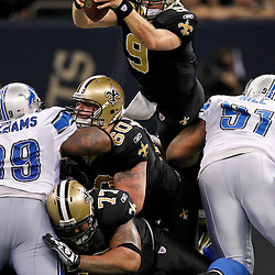 January 7, 2012; New Orleans, LA, USA; New Orleans Saints quarterback Drew Brees (9) dives over the line for a first down against the Detroit Lions during third quarter of the 2011 NFC wild card playoff game at the Mercedes-Benz Superdome. Mandatory Credit: Derick E. Hingle-US PRESSWIRE
