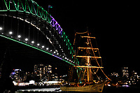 Sydney Harbour bridge lit up for Vivid Sydney 2017 with a tall ship next to the bridge
