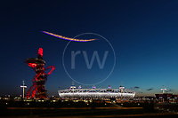 Paralympics London 2012 - ParalympicsGB - Opening Ceremony held at the Stadium 29th August 2012. A plane flys past overhead with fireworks coming out of the back<br /> <br /> Photo: Richard Washbrooke/ParalympicsGB