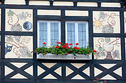 Ornate traditional decoration on half timbered house in popular town of Rudesheim on River Rhine in Germany
