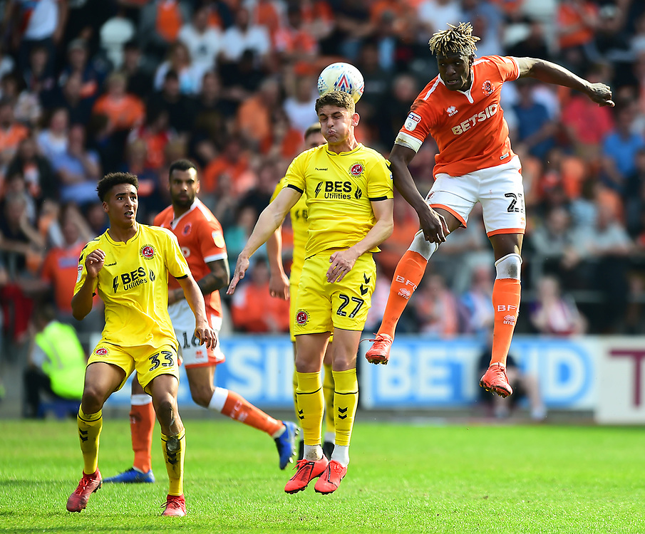 Blackpool's Armand Gnanduillet competes in the air with Fleetwood Town's Harrison Biggins<br /> <br /> Photographer Richard Martin-Roberts/CameraSport<br /> <br /> The EFL Sky Bet League One - Blackpool v Fleetwood Town - Monday 22nd April 2019 - Bloomfield Road - Blackpool<br /> <br /> World Copyright © 2019 CameraSport. All rights reserved. 43 Linden Ave. Countesthorpe. Leicester. England. LE8 5PG - Tel: +44 (0) 116 277 4147 - admin@camerasport.com - www.camerasport.com