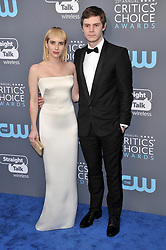 Emma Roberts (L) and Evan Peters at The 23rd Annual Critics' Choice Awards held at the Barker Hangar on January 11, 2018 in Santa Monica, CA, USA (Photo by Sthanlee B. Mirador/Sipa USA)