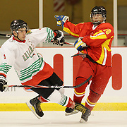 Bulgaria's Radovanov Kristian (left) challenges China's Zhang Cheng  during China's 6-2 win during the Bulgaria V China match at the 2012 IIHF Ice Hockey World Championships Division 3 held at Dunedin Ice Stadium. Dunedin, Otago, New Zealand. 17th January 2012. Photo Tim Clayton