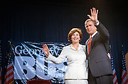 Texas Gov. George W. Bush and his wife Laura wave during a campaign fundraising event June 22, 1999 in Washington, DC. Bush is the frontrunner for the Republican presidential nomination in the Year 2000.