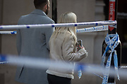 The morning after the terrorist attack at Fishmongers Hall on London Bridge, in which Usman Khan a convicted, freed terrorist killed 2 during a knife a attack, then subsequently tackled by passers-by and shot by armed police - members of the public walk around the cordoned off area, on 30th November 2019, in London, England.