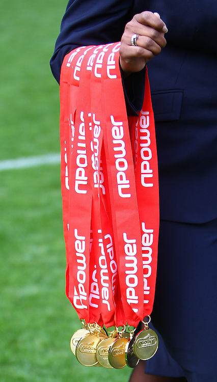Picture by John Rainford/Focus Images Ltd. 07506 538356.05/05/12.Npower League 1 winners medals are brought to the podium at The Valley stadium, London.