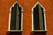Double windows in red facade.