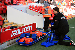 A medic prepares his equipment pitch side before the Premier League match at Anfield, Liverpool.