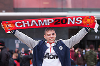 Football - Premier League 2012 / 2013 - Manchester United vs. Swansea<br /> A fan displays his 'Champions' scarf at Old Trafford