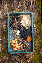 Showing material not suitable for adding to a compost heap