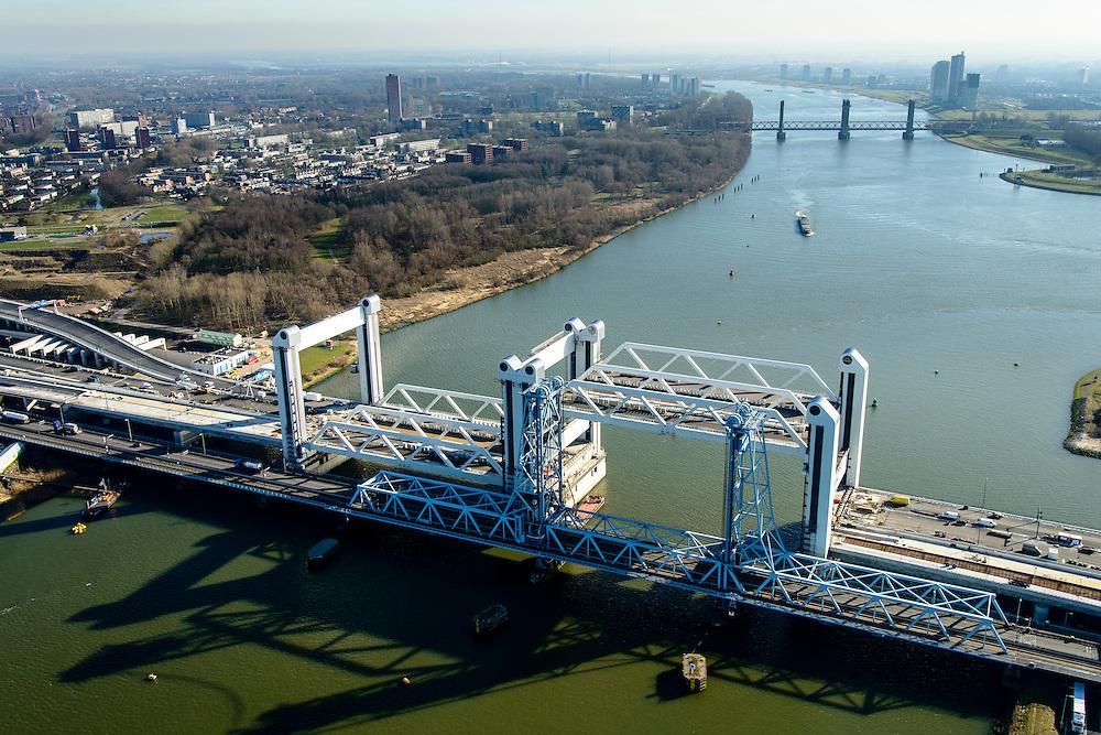 Nederland, Zuid-Holland, Rotterdam, 18-02-2015; bouw van de nieuwe Botlekbrug.<br /> De brug over de Oude Maas is een hefbrug, een van de twee brugdelen in geheven toestand. De oude brug met heftorens in de voorgrond, Spijkenisserbrug in het verschiet.<br /> Construction of the new Botlek bridge.<br /> The bridge over the Oude Maas is a vertical-lift bridge or lift bridge, one of the two bridge sections raised. <br /> luchtfoto (toeslag op standard tarieven);<br /> aerial photo (additional fee required);<br /> copyright foto/photo Siebe Swart