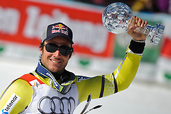 15-03-2012 SKIEN: FIS WORLD CUP 2012: SCHLADMING<br /> Aksel Lund Svindal of Norway Worldcup Champion of SuperG Worldcup with SuperG crystal globe during SuperG Worldcup winner ceremony of FIS Ski Alpine World Cup at Planai Stadium in Schladming<br /> **NETHERLANDS ONLY** <br /> ©2012-FotoHoogendoorn.nl/EXPA/Sandro Zangrando