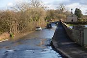Mini Cooper S car stuck in River Avon flood water, Kellaways bridge, Wiltshire, England, UK 24/12/20