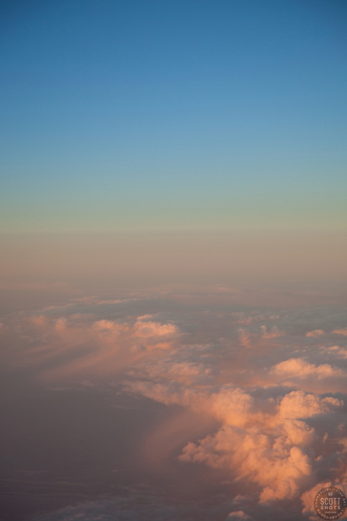 """""""Sunset Above the Clouds 2"""" - This sunset was photographed from an airplane above the clouds."""