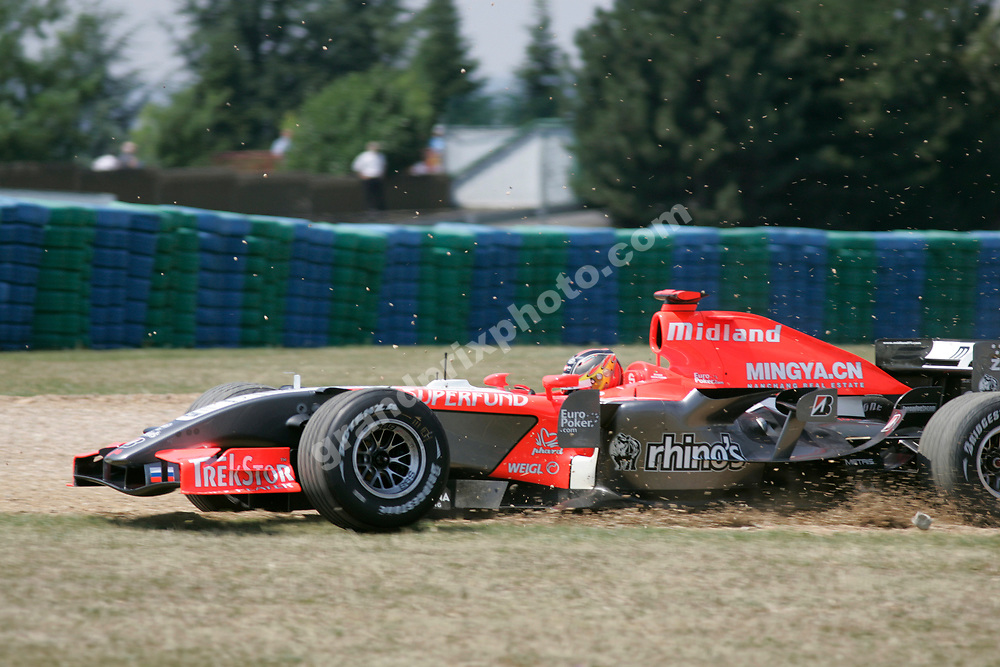 Tiago Monteiro (Midland-Toyota) went off the circuit during qualifying for the 2006 French Grand Prix at Magny-Cours. Photo: Grand Prix Photo