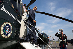 President Barack Obama disembarks Marine One at the Brackett Field landing zone in San Dimas, Calif., Oct. 10, 2014. (Official White House Photo by Pete Souza)<br /> <br /> This official White House photograph is being made available only for publication by news organizations and/or for personal use printing by the subject(s) of the photograph. The photograph may not be manipulated in any way and may not be used in commercial or political materials, advertisements, emails, products, promotions that in any way suggests approval or endorsement of the President, the First Family, or the White House.