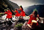Performing the hula kahiko, or ancient hula dance, performers blend simple footwork with hand gestures to illustrate the myths and histories of their families on the rim of Waimea Canyon on Kauai.  The canyon is also known as the Grand Canyon of the Pacific and is some ten miles long and up to 3,000 feet deep. © Steve Raymer / National Geographic Creative