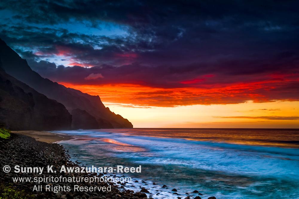 Sunset over Kalalau Beach, Na Pali Coast State Park, Kauai, Hawaii.