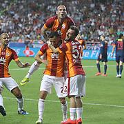 Galatasaray's Yasin Oztekin (C) celebrate his goal with team mate during their Turkish Superleague soccer match Mersin Idman Yurdu between Galatasaray at the Mersin stadium in Mersin Turkey on Sunday 12 May 2015. Photo by Aykut AKICI/TURKPIX
