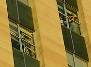 6/27/08 Omaha, NEB.Repairing broken windows on the Mutual of Omaha Building.Damage photos from the storm that hit Omaha on Friday afternoon..Chris Machian/Omaha World Herald