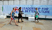 © Licensed to London News Pictures. 03/10/2011. MANCHESTER. UK. Women walk past a hoarding carrying the Conservative Party logo at The Conservative Party Conference at Manchester Central today, October 3, 2011. Photo credit:  Stephen Simpson/LNP