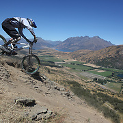 Chris Patton, USA, in action during the New Zealand South Island Downhill Cup Mountain Bike series held on The Remarkables face with a stunning backdrop of the Wakatipu Basin. 150 riders took part in the two day event. Queenstown, Otago, New Zealand. 9th January 2012. Photo Tim Clayton